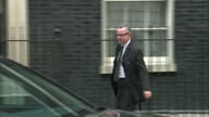 Exterior shot Michael Gove Chief Whip leaving the last cabinet meeting before the general election gets into waiting car whilst media ask if he will...
