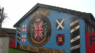 Exterior shot of a loyalist Ulster Defence Union ' Young Newton' mural on the end wall of a row of terraced houses Sectarian murals in Belfast on...
