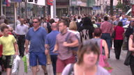 Exterior shot of crowds of shoppers walking along a busy high street in Cardiff on a Summer day>> on August 08 2014 in Cardiff Wales