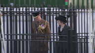 Exterior shot Prime Minister Theresa May arrives at war memorial service followed by Michael Fallon Defence Secretary and military dignitaries The...