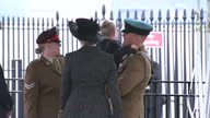 Exterior shot Prime Minister Theresa May meets greets couple with young child child struggles and has a small tantrum during meeting Parents and May...