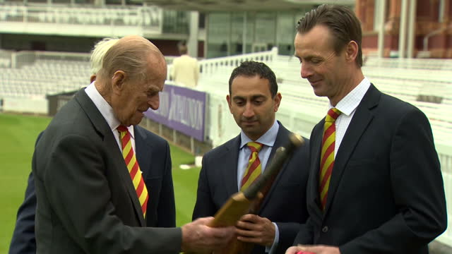 Exterior shot Prince Philip visits Lord's Cricket Ground to open new stand he walks from the pavillion with MCC members inc Chairman Gerald Corbett...
