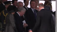 Exterior shot Prince William Duke of Cambridge and Catherine Duchess of Cambridge arrive at war memorial service and greets people including Prince...