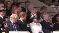 Exterior shot Princess Anne The Princess Royal sitting next to Prince Andrew Duke of York while chatting to Boris Johnson UK Foreign Secretary with...