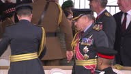 Exterior shot Priti Patel Secretary of State for International Development talking to man in decorated uniform in stalls at a war memorial service...