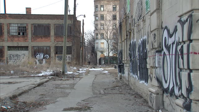 Exterior shots abandoned run down high rise buildings in Detroit Michigan Buildings have broken windows and are covered in graffiti Run Down Detroit...