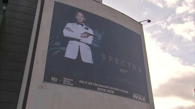 Exterior shots advertising posters on side of bus and building for James Bond 007 film Spectre on October 20 2015 in Bradford England