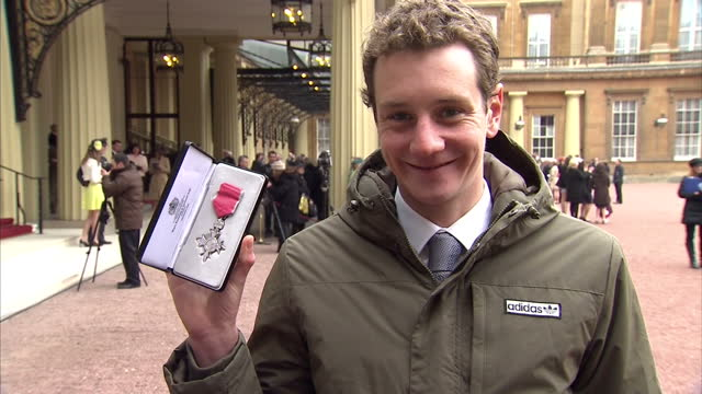 Exterior shots Alastair Brownlee poses with his MBE at Buckingham Palace Alastair Brownlee Poses with MBE on March 26 2013 in London England