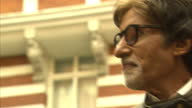 LONDON Exterior shots Amitabh Bachchan poses for cameras with Dhanush Haasan