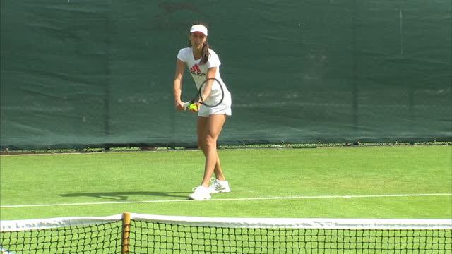 Exterior shots Ana Ivanovic serving on practice court at Wimbledon Ana Ivanovic Trains on Court on June 26 2012 in Wimbledon England