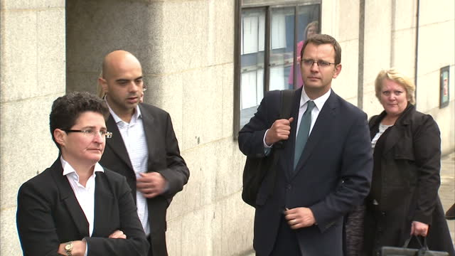 Exterior shots Andy Coulson walks across road stands outside the Old Bailey with his legal team Andy Couslon Arrives at the Old Bailey on September...