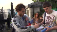 Exterior shots Andy Murray departs Wimbledon signs autographs for waiting fans as he waits for his pickup to arrive Exterior shots Andy Murray walks...