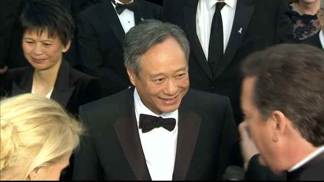 Exterior shots Ang Lee chats to the press on the red carpet Ang Lee on the Red Carpet at Dolby Theatre on February 25 2013 in Hollywood California