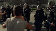 Exterior shots angry migrants asylum seekers refugees protesting confronted by Hungarian riot police outside Keleti Train station in Budapest on...