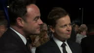 Exterior shots Ant and Dec TV Presenters talking to reporter on National Television Awards red carpet on January 20 2016 in London England