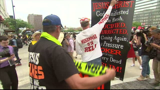 CLEVELAND Exterior shots anti Muslim protesters islamophobia holding banners with 'Every real muslim is a terrorist 'Muhammed is in hell' and ' Allah...