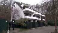 Exterior shots apartment building where Germanwings copilot Andreas Lubitz lived with police officers standing outside building on March 27 2015 in...