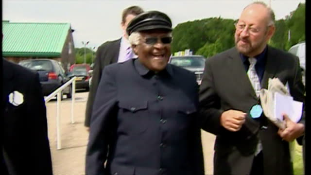 Exterior shots Archbishop Desmond Tutu arrives at Yorkshire International Business Convention shakes a few hands on the way