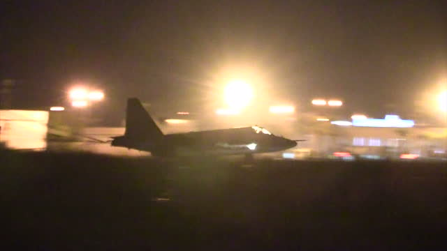 Exterior shots at night of a Sukhoi Su25 Frogfoot ground attack plane landing at Latakia airbase after bombing raids over Syrian opposition targets...