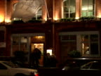 Exterior shots at night of Limelight nightclub in Soho with people standing outside and walking in before shot of flag on door with Limelight logo...