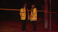 Exterior shots at night of police and cordon tape at the scene of the killing of 11yearold Rhys Jones on 23 August 2007 in Liverpool United Kingdom