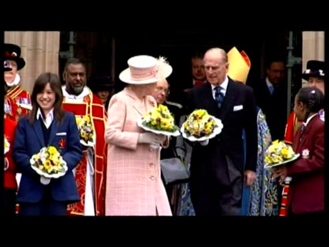 exterior shots Beefeaters file out of Manchester Cathedral form up outside Exterior shots Queen Elizabeth II and Prince Philip leave cathedral...
