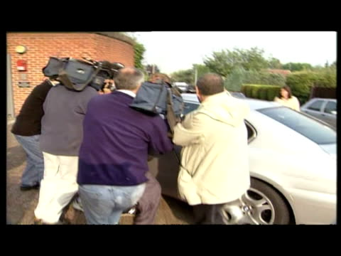 Exterior shots BMW carrying Michael Barrymore arrives drive past press Exterior front view Epping Forest District Council Exterior shots silver BMW...