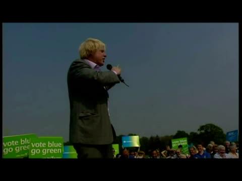 exterior shots Boris Johnson stands with David Cameron at rally exterior shots Boris Johnson speaks at rally with cutaways David Cameron listening