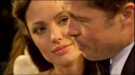 Exterior shots Brad Pitt and Angelina Jolie talking to press on red carpet at BAFTA Awards