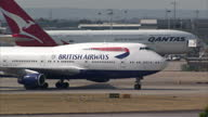 Exterior shots British Airways Boeing 747 passenger plane taxiing to runway at Heathrow airport on July 01 2015 in London England