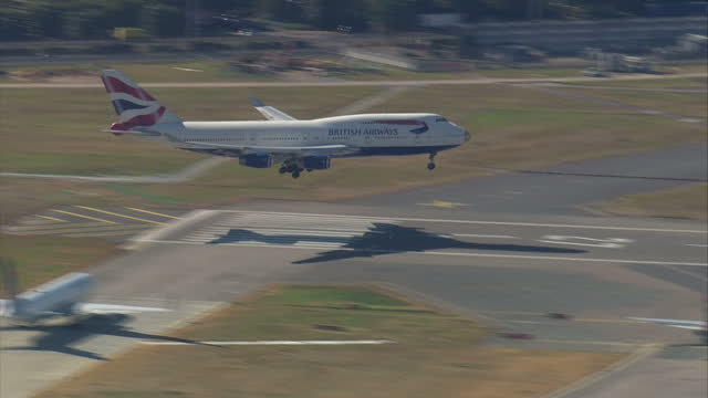 Exterior shots British Airways flight BA2016 with gold nose lands at Heathrow Airport bringing Team GB athletes back from the Rio 2016 Olympic Games...