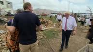 Exterior shots British Foreign Secretary Boris Johnson speaks to locals / Exterior shots Boris Johnson hugging local woman / Exterior shots Boris...