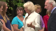 Exterior shots Camilla at Cornish Orchards meeting staff shaking hands on July 14 2014 in Liskeard England