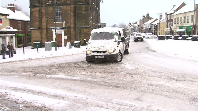 Exterior shots cars sliding skidding on snow ice covered road in Gisborough Severe weather has affected much of northern Britain Cars struggle in the...