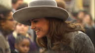Exterior shots Catherine Duchess of Cambridge arriving for Commonwealth Observance Service talking to children and royal fans on March 14 2016 in...