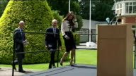 Exterior shots Catherine Duchess of Cambridge walks to stage and listens to speech whilst on visit to Bletchley Park on June 18 2014 in Milton Keynes...