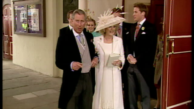 Exterior shots Charles and Camilla emerge from the Guildhall as man and wife and wave to crowds on 9th April 2005 Windsor England