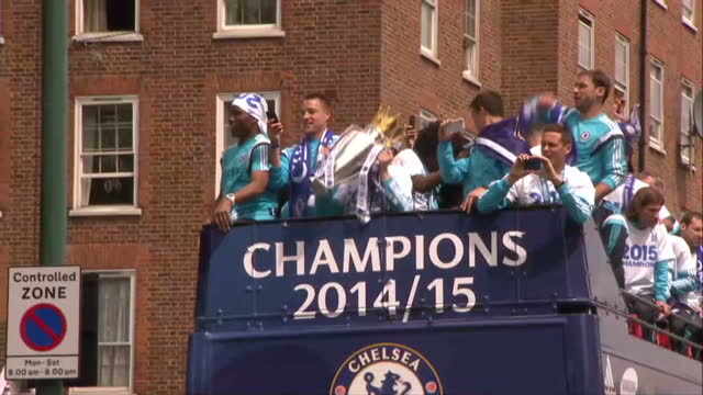 Exterior shots Chelsea FC players and teams on open top bus celebrating at victory parade for Premier League on May 25 2015 in London England