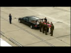 exterior shots coffin draped in Union Flag holding the body of Corporal Stephen Thompson is put into waiting Hearse on the airfield at RAF Lyneham 5...