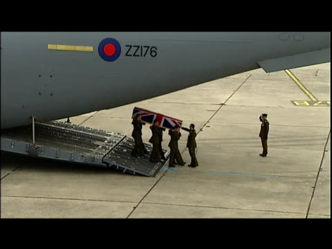 exterior shots coffin draped in Union Flag holding the body of Corporal Richard Green carried off plane by British soldiers 5 British soldiers killed...