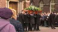 Exterior shots comedian Frank Carson's casket carried from St Patrick's Church Belfast crowds of mourners line streets Frank Carson's Coffin Carried...