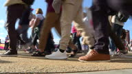 Exterior shots crowds arriving at the Olympic Stadium for the World Athletics Championships 2017 shot of anon anonymous shoes walking trainers shoes...