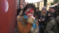 BRIXTON Exterior shots crying David Bowie fan wearing face paint and posing for cameras