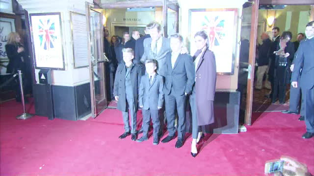 Exterior shots David Beckham Victoria Beckham pose with sons Romeo Cruz Brooklyn on red carpet Viva Forever Spice Girls Musical Premiere at...