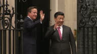 Exterior shots David Cameron British Prime Minister and Xi Jinping Chinese President standing outside 10 Downing Street shake hands and walk into...