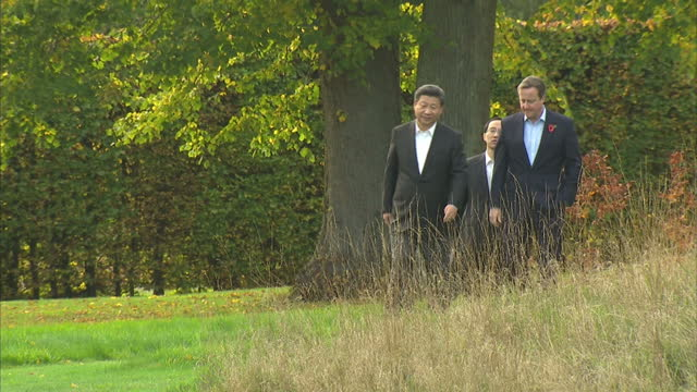 Exterior shots David Cameron British Prime Minister showing Xi Jinping Chinese President around the grounds at Chequers The pair walk around talking...