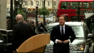 Exterior shots David Cameron Prime Minister arrives back at Downing Street after informing the Queen that he has dissolved Parliament and gives...