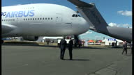 Exterior shots David Cameron walking on runway looking at the new Airbus A330 on July 14 2014 in London England