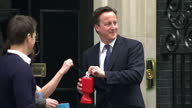 Exterior shots David Cameron walks out from Number 10 Downing Street with Gethin Jones poppy seller Exterior shots Gethin Jones pins poppy on David...