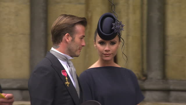 Exterior shots David Victoria Beckham arrive at Westminster Abbey Interior shots David Victoria Beckham walk inside the Abbey amongst the guests Sky...